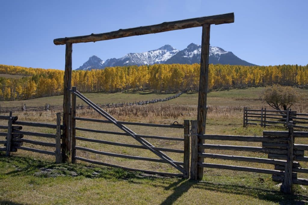 wooden fence frames san juan mountains