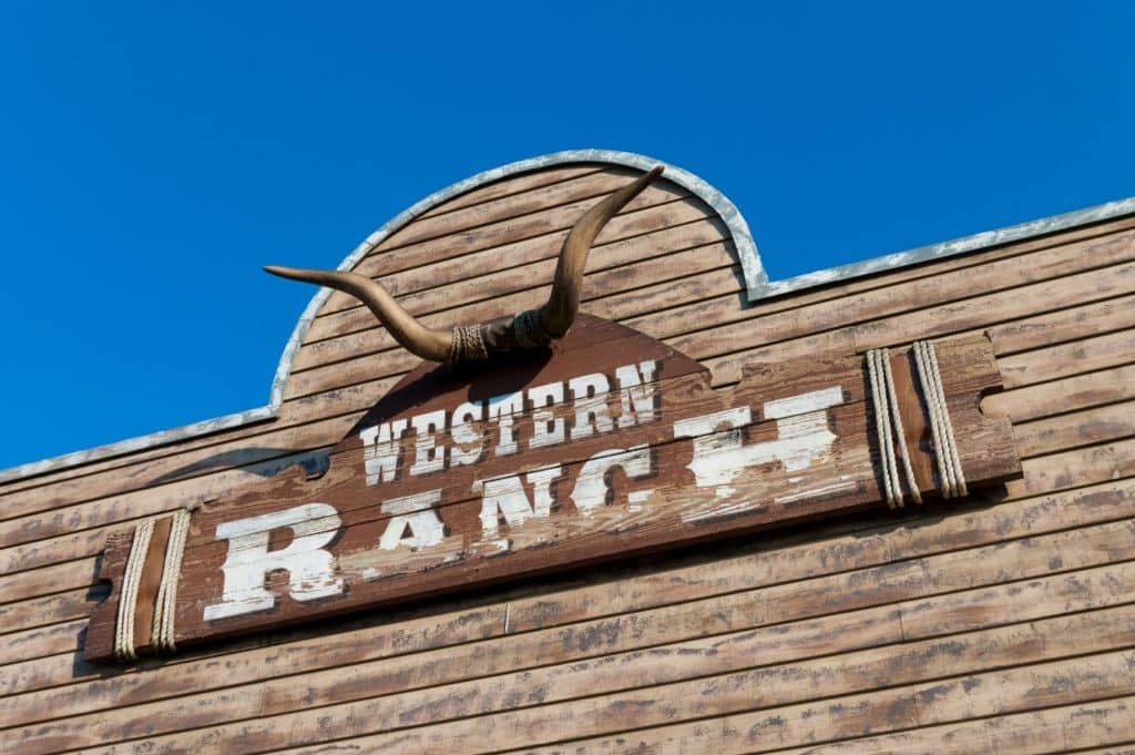bull skull and western ranch board on a wooden facade