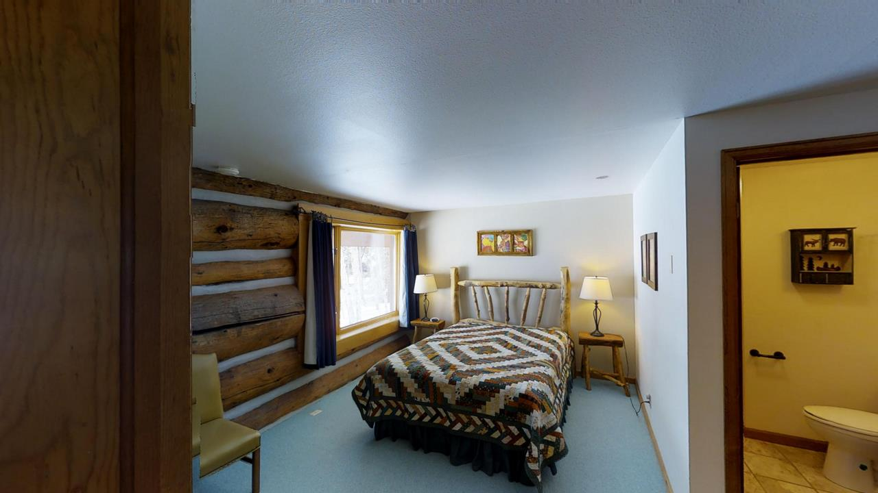 Lake-Fork-River-Ranch-Main-Lodge-Guest Bed